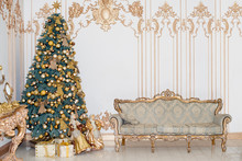 Beautiful Decorated Golden Christmas Tree With Present Boxes In Luxury Classic Interior.