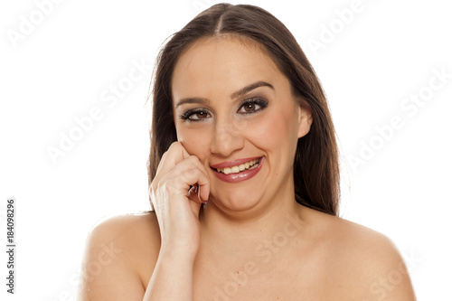 Fototapeta young silly woman make stupid faces on white background
