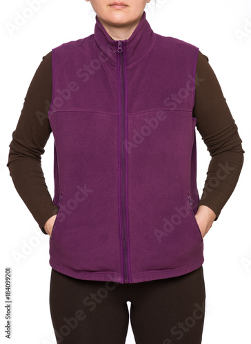 Young woman wearing purple fleece vest isolated on white background Wallpaper Mural