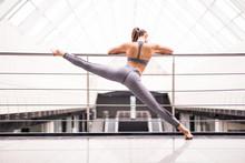 Beautiful Girl In Sportswear Is Doing Yoga In Sports Hall