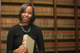 Portrait of a young attractive African American woman. Portrait of a woman attorney. Civi Rights lawyer
