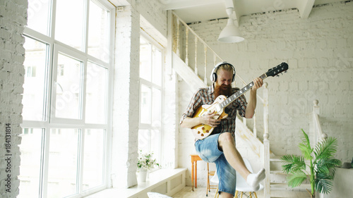Funny Bearded Man Dance On Bed Singing And Playing Electric Guitar