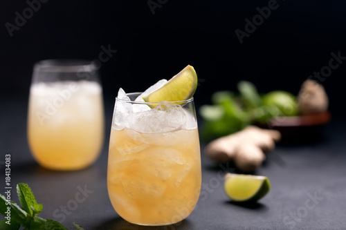 Fresh cocktail prepared with ginger beer, lime and ice Poster