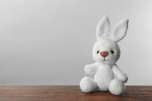 Cute Knitted Bunny Toy On Tabl...