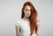 Redhead Teenage Girl With Healthy Freckled Skin Looking At Camera With Serious Emotion