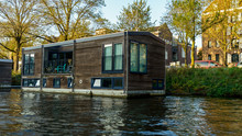Traditional Floating Boat House In Amsterdam Canals, The Netherlands, October 13, 2017