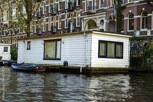 Photo  Traditional Floating boat house in Amsterdam canals, the Netherlands, October 13