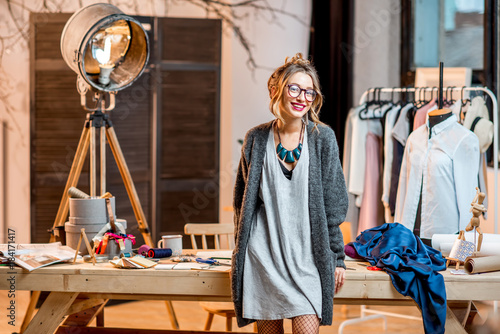 Fotografie, Obraz  Portrait of a young female fashion designer standing at the office with differen