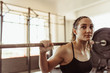 Leinwanddruck Bild - Young female doing squats at gym