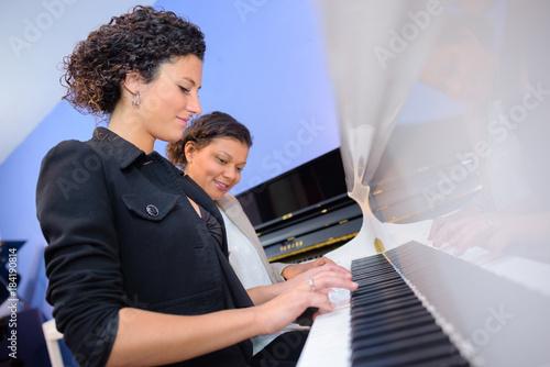 Photo  Women playing duet on piano