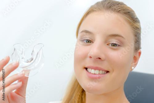 Obraz na plátně Woman holding mouthguard