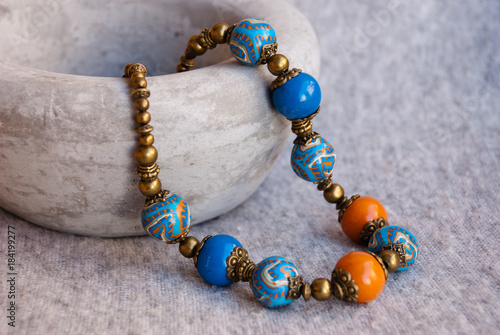 Fotomural Beautiful woman beads in oriental style with ceramic bowl