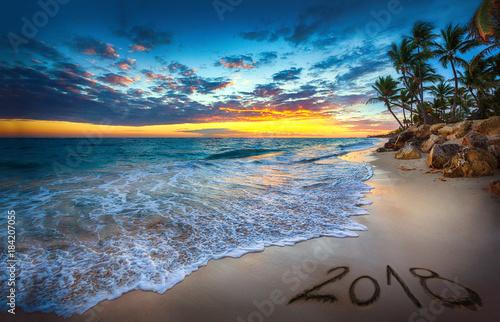 Fototapeta Happy New Year 2018 concept, lettering on the beach. Sea sunrise obraz na płótnie