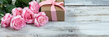 Six Pink Roses And Giftbox On ...