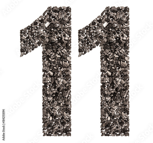 Fotografia  Arabic numeral 11, eleven, from black a natural charcoal, isolated on white back