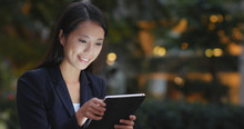 Young Businesswoman Using Tabl...
