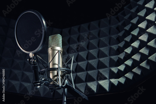 Photo  Modern professional microphone in recording studio