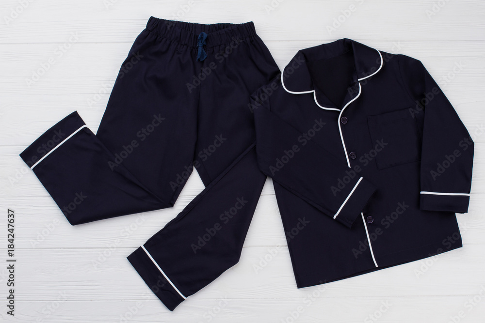 Fototapety, obrazy: Classic pajama for young boy. Navy shirt and pants decorated with white edging. Simple and elegant.