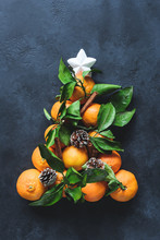 Christmas Tree With Tangerines, Spices And Pine Cones Decorated With White Star. Top View, Toned Image. Traditional Christmas Background