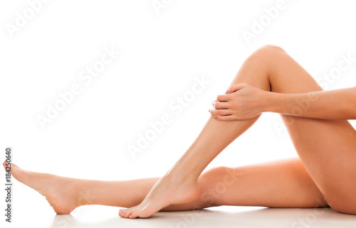 Fototapety, obrazy: Beautiful smooth and shaved woman's legs. Isolated on white background. Skincare treatment concept