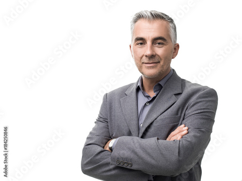 Valokuva Confident businessman posing with arms crossed