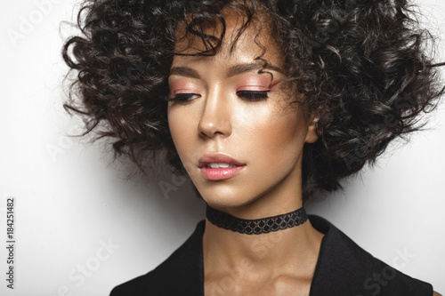 Beautiful woman with afro curls hairstyle Wallpaper Mural