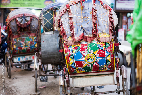 Fotografie, Obraz Colorful rickshaw carriage in line on the road, Kathmandu, Nepal.