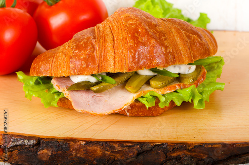 Staande foto Snack Croissat with ham and cucumbers