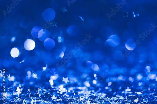 Canvas Prints Countryside christmas background with falling blue shiny confetti stars