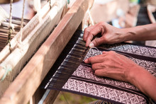 Close Up Weavers Are Weaving With A Loom And Threading.
