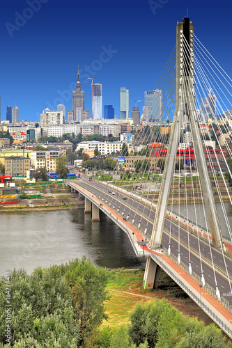 Poland, Mazovia province, Warsaw - 2012/09/01: Panoramic view of the city center with the Swietokrzyski Bridge over Vistula river