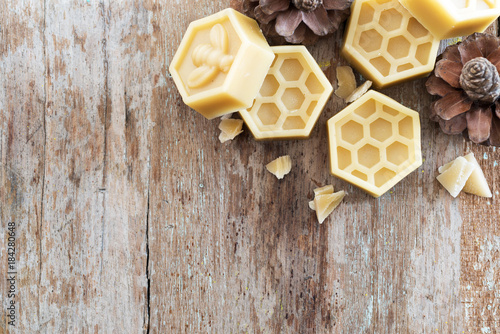 natural yellow beeswax on wooden background. Wallpaper Mural
