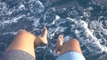 Feet Of Man On A Boat Above Sea
