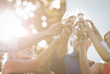 Friends Toasting Glasses Of Champagne In Balcony