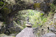 Stone cairn under the bridge, Rabacal, Madeira island, Portugal