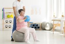 Senior Woman Exercising In Cli...