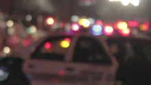 Police Lights Out Of Focus In The Background