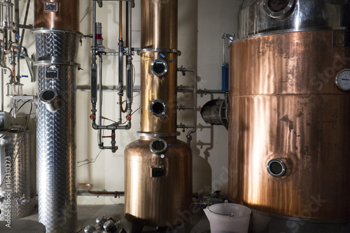Copper still alembic inside distillery Wallpaper Mural
