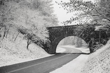 Scenic View Of Road Passing Through Snowy Landscape