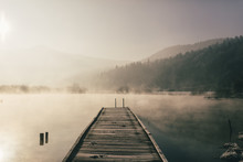 Mysterious Lake On An Early Winter Morning Photographed In Backlight In Central Slovenia