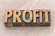 profit word abstract in wood type