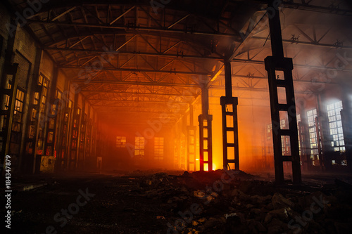 Foto op Aluminium Industrial geb. Fire in the factory. Burned by fire industrial building