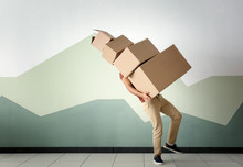 Man With Moving Boxes Near Color Wall