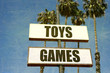 aged and worn toys and games sign