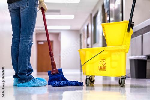Fotografie, Obraz  Mopping wet floor in hallway