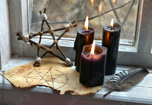 Black magic ritual with pentagram and black candles. Occult, esoteric, divination and wicca concept, mystic background