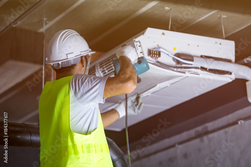 Male technician Maintenance of indoor air conditioners. Canvas Print