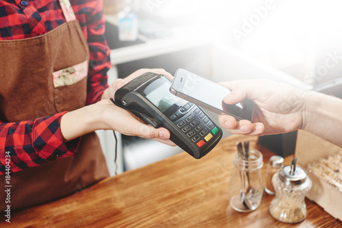 Contactless payment by phone.