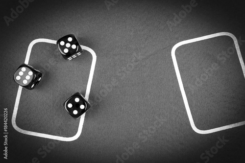 фотография  risk concept - playing dice on a green gaming table