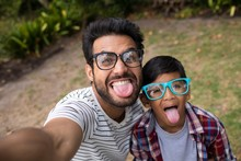 High Angle View Of Father And Son Wearing Sunglasses